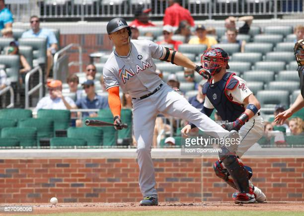 Miami Marlins right fielder Giancarlo Stanton gets hit by a pitch in the first inning of the MLB game between the Atlanta Braves and the Miami...