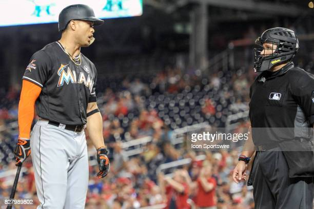 Miami Marlins right fielder Giancarlo Stanton has words with home plate umpire Manny Gonzalez after being called out on strikes during an MLB game...