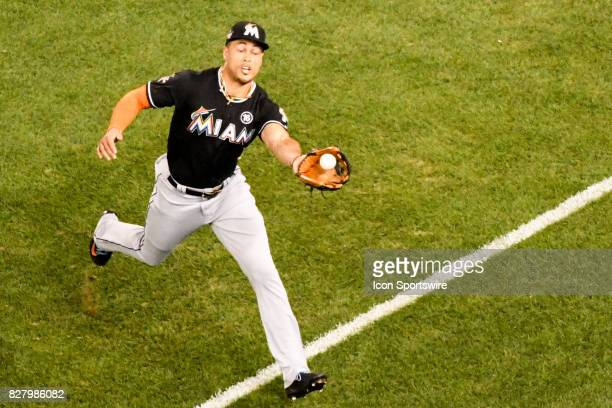 Miami Marlins right fielder Giancarlo Stanton makes a running catch in the fifth inning during an MLB game between the Miami Marlins and the...