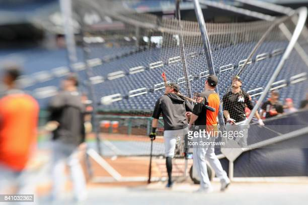 Miami Marlins right fielder Giancarlo Stanton takes batting practice as many of he teammates watch prior to an MLB game between the Miami Marlins and...