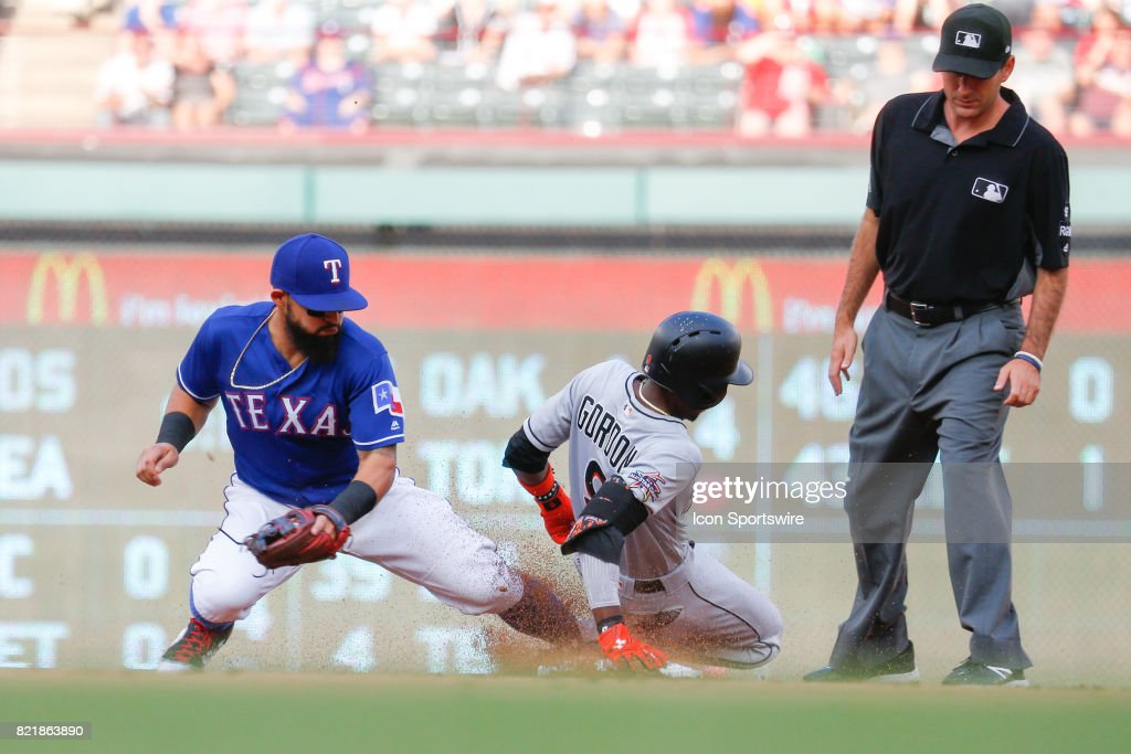 Miami Marlins Second base Dee Gordon (9) slides into second during the MLB game between the Miami Marlins and Texas Rangers on July 24, 2017 at Globe Life Park in Arlington, TX.