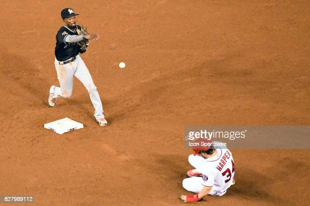 Miami Marlins second baseman Dee Gordon completes a sixth inning double play forcing Washington Nationals right fielder Bryce Harper out at second...
