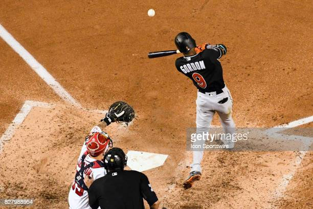 Miami Marlins second baseman Dee Gordon hits a fifth inning single during an MLB game between the Miami Marlins and the Washington Nationals on...