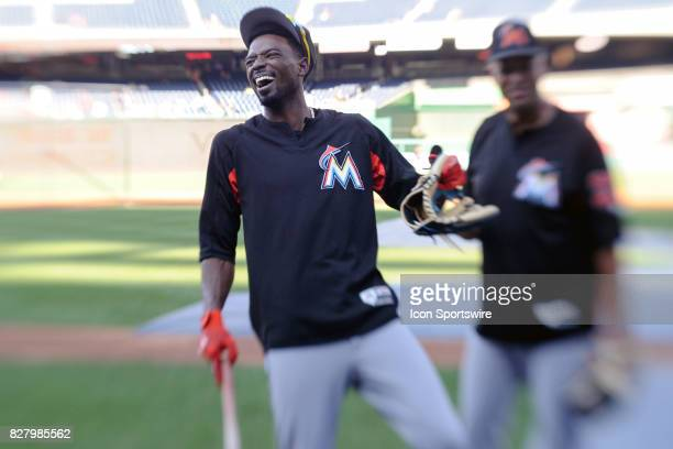 Miami Marlins second baseman Dee Gordon shares a laugh with outfield/baserunning coach Lorenzo Bundy prior to an MLB game between the Miami Marlins...