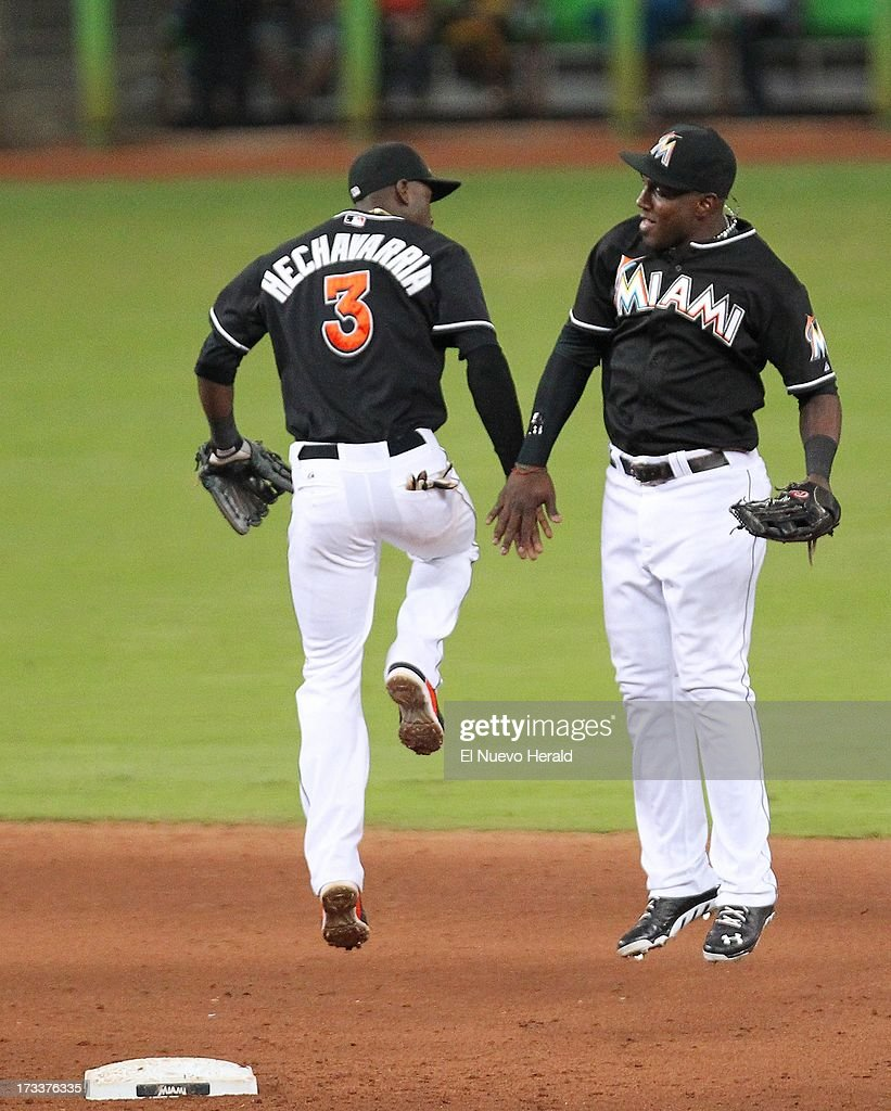 Miami Marlins shortstop Adeiny Adeiny Hechavarria (3) celebrates with teammate with Marcell Ozuna after an 8-3 win against the Washington Nationals at Marlins Park in Miami, Florida, on Friday, July 12, 2013.