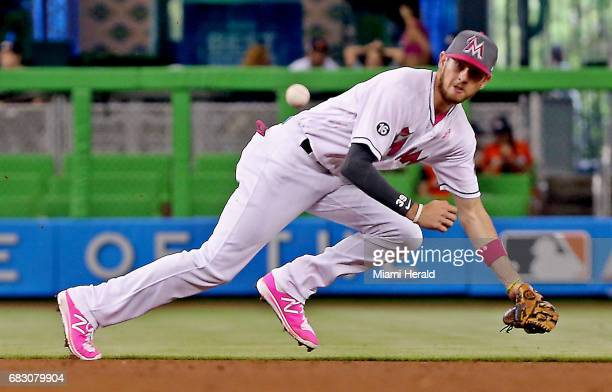 Miami Marlins shortstop JT Riddle fields a grounder against the Atlanta Braves on Sunday May 14 2017 at Marlins Park in Miami Fla