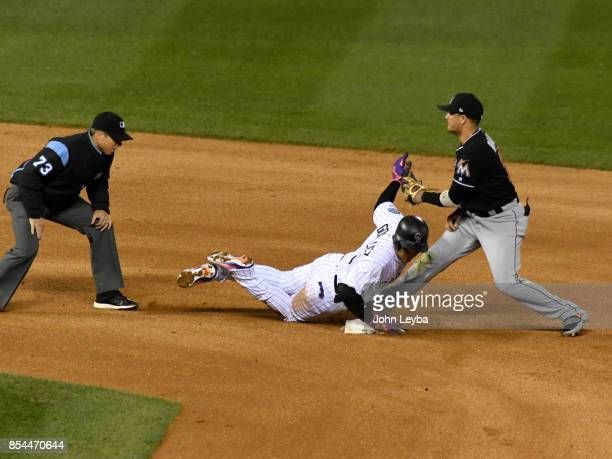Miami Marlins shortstop Miguel Rojas tags out Colorado Rockies right fielder Carlos Gonzalez at second base as he is thrown out by right fielder...