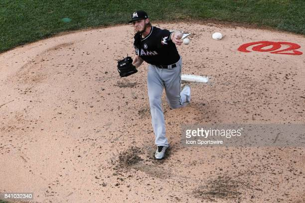 Miami Marlins starting pitcher Adam Conley pitches in the fifth inning during an MLB game between the Miami Marlins and the Washington Nationals on...