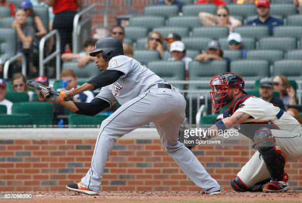 Miami Marlins starting pitcher Jose Urena attempts to bunt during the MLB game between the Atlanta Braves and the Miami Marlins on August 6 2017 at...