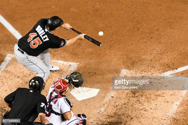 Miami Marlins starting pitcher Vance Worley hits a sacrifice bunt in the fifth inning during an MLB game between the Miami Marlins and the Washington...