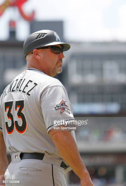Miami Marlins Third Base Coach and former Manager of the Atlanta Braves Fredi Gonzalez looks on during the MLB game between the Atlanta Braves and...