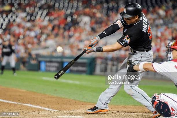 Miami Marlins third baseman Derek Dietrich hits a seventh inning RBI single during an MLB game between the Miami Marlins and the Washington Nationals...