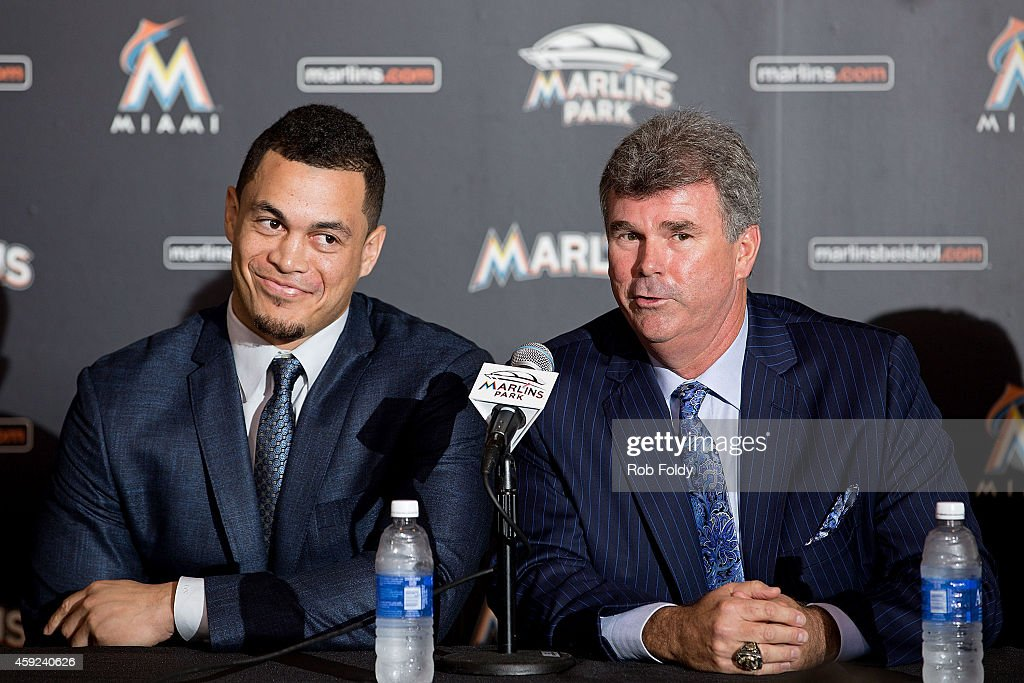 Miami Marlins Vice President General Manager Dan Jennings speaks as Giancarlo Stanton looks on during a press conference at Marlins Park on November...