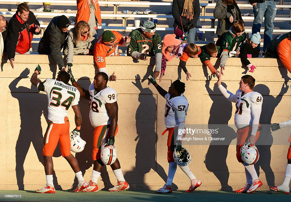 Miami players say goodbye to their fans as the suns sets at Wallace Wade Stadium on Saturday, November 24, 2012, in Durham, North Carolina. The Miami Hurricanes defeated the Duke Blue Devils, 52-45.
