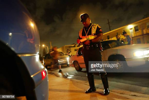 Miami Police Officer A Mathis writes a ticket for a traffic violation April 30 2004 in Miami Florida The Miami Police department's traffic...