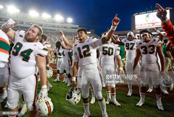 Miami quarterback Malik Rosier sings the school's alma mater with teammates and fans after a 2420 win against Florida State at Doak Campbell Stadium...