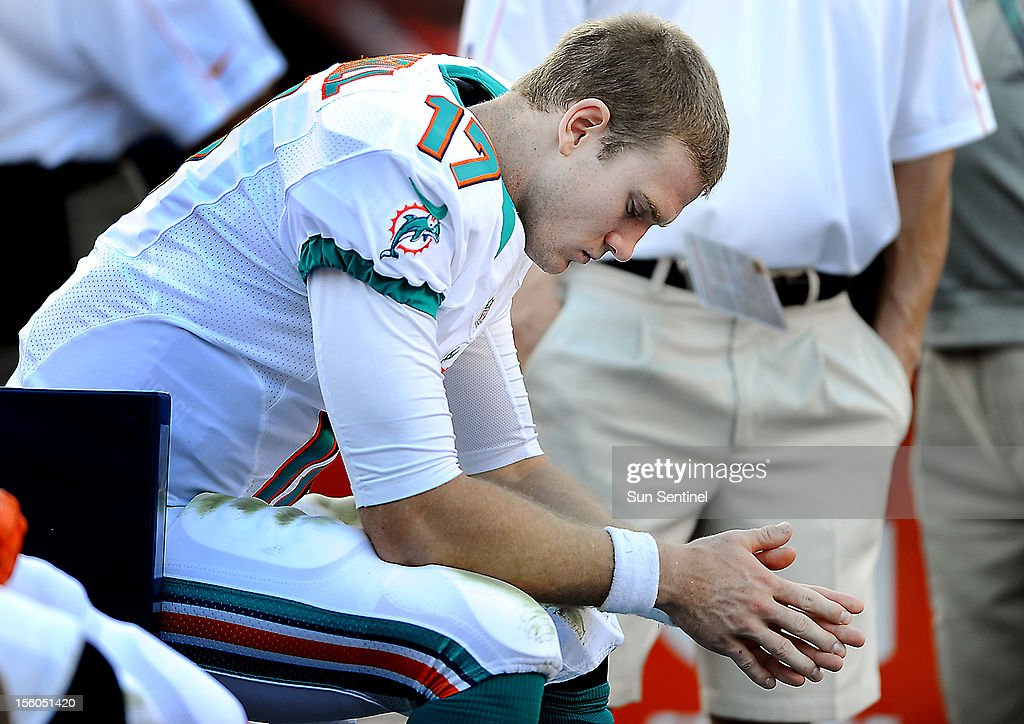 Miami quarterback Ryan Tannehill lowers his head in the 4th quarter after a frustrating game against the Tennessee Titans at Sun Life Stadium in Miami, Florida, Sunday, November 11, 2012. The Tennessee titans defeated the Miami Dolphins, 37-3.