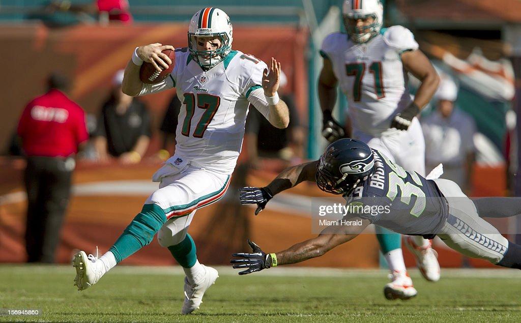 Miami quarterback Ryan Tannehill scrambles past Seattle Seahawks cornerback Brandon Browner (39) for a first down in the third quarter as the Miami Dolphins beat the Seattle Seahawks 24-21 at Sun Life Stadium in Miami Gardens, Florida, November 25, 2012.