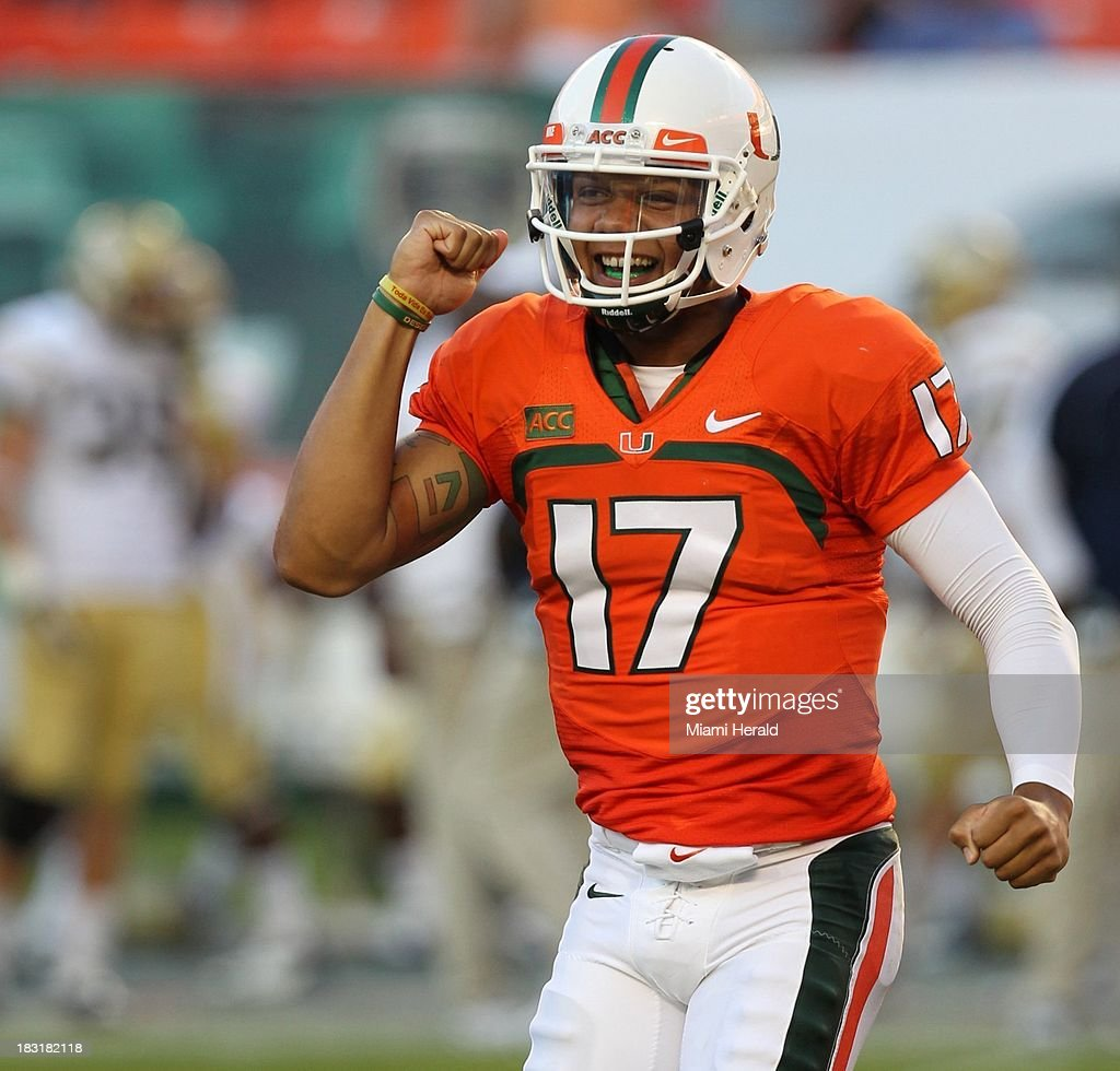 Miami quarterback Stephen Morris celebrates after a touchdown run by Dallas Crawford against Georgia Tech late in the fourth quarter at Sun Life Stadium in Miami, Florida, Saturday, October 5, 2013. Miami defeated Georgia Tech, 45-30.