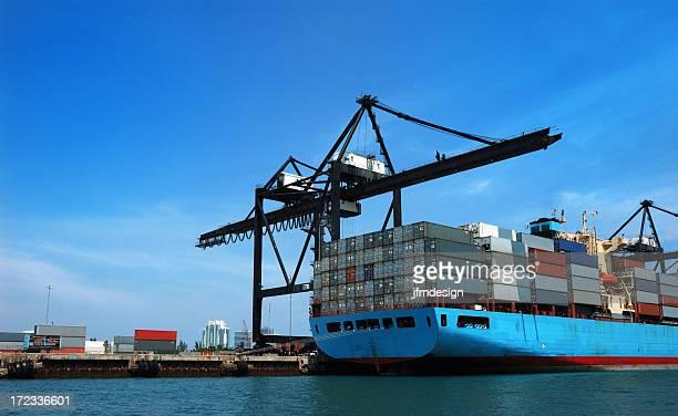 miami seaport crane and container cargo ship