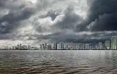 Miami skyline with moody sky.