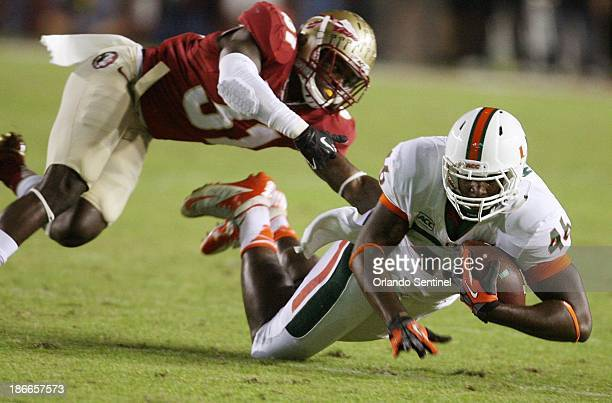 Miami tight end Clive Walford comes up with a catch under Florida State defensive back Terrence Brooks in the first half against Miami at Doak...