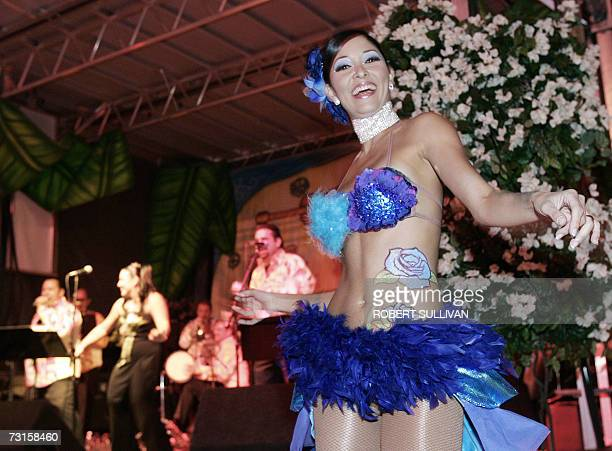 A dancer performs with a band on the beach 30 January 2007 during a party for Super Bowl XLI on Miami Beach Florida The Super Bowl has been raised to...