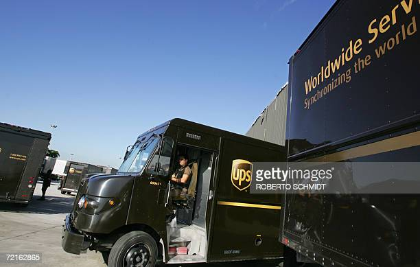 A delivery truck driver for United Parcel Service leaves a package distribution hub as he begins deliveries in Miami Florida 12 October 2006...