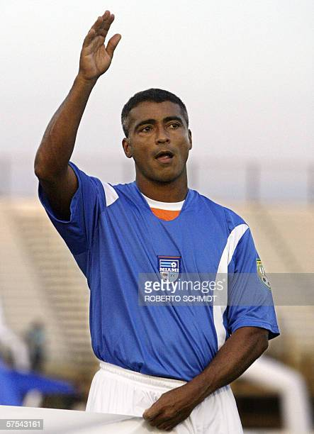 Brazilian soccer star Romario de Souza Faria also know as 'Romario' the newly acquired member of the Miami FC soccer team waves at supporters before...