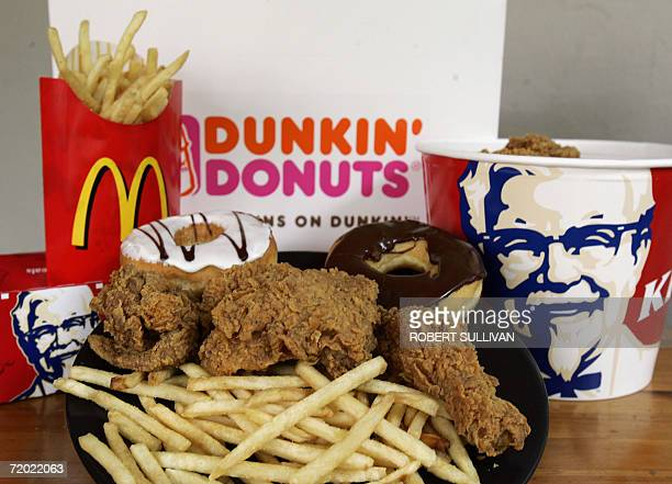 Doughnuts from Dunkin' Donuts French fries from McDonalds and fried chicken from Kentucky Fried Chicken are displayed 27 September 2006 in Miami...