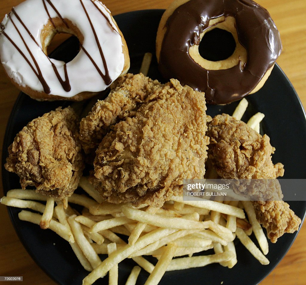 Doughnuts from Dunkin' Donuts French fries from McDonald's and fried chicken from Kentucky Fried Chicken are displayed 27 September 2006 in Miami...