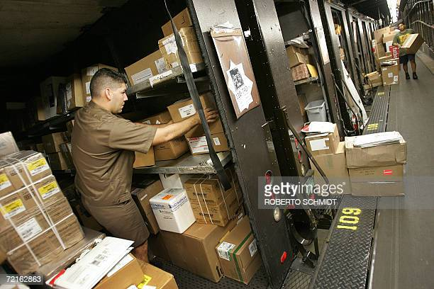 Gerardo Zamudio a truck delivery driver for United Parcel Service makes sure the packages in his truck are organized at a distribution hub in Miami...