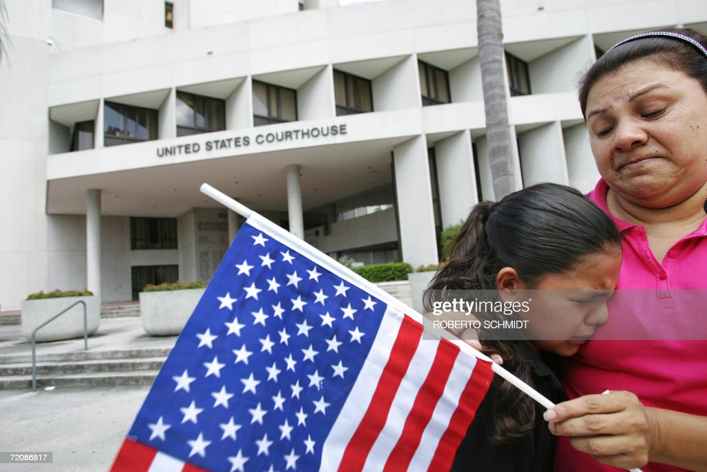 Marta comforts her weeping US born daughter Stephanie as they stand in front the US Federal Courthouse in Miami Florida 04 October 2006 Lawyers...