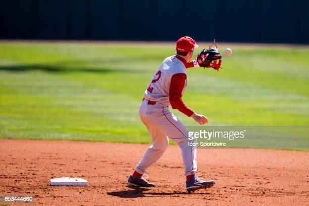 Miami University infielder Will Vogelgesang grabs a thrown in ball during pregame warmups between the Miami University Redhawks and the Kentucky...