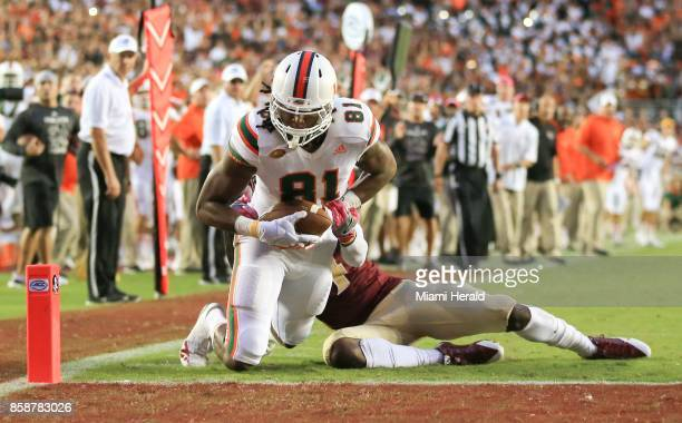 Miami wide receiver Darrell Langham finishes a 23yard touchdown catch in the fourth quarter in front of Florida State defensive back Tarvarus...