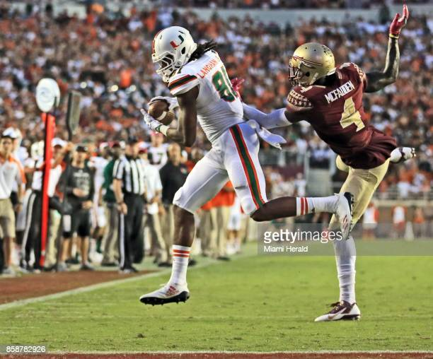 Miami wide receiver Darrell Langham makes a 23yard touchdown catch in the fourth quarter in front of Florida State defensive back Tarvarus McFadden...