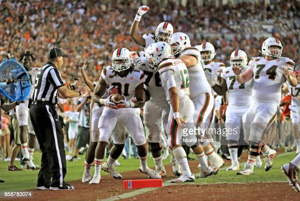Miami wide receiver Darrell Langham secures a 23yard touchdown catch in the fourth quarter against Florida State touching off a celebration by the...