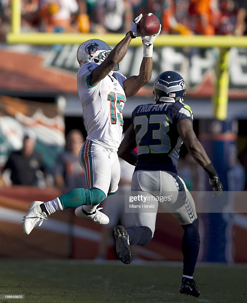 Miami wide receiver Davone Bess catches this pass to the 36 in the fourth quarter behind cornerback Marcus Trufant (23) as the Miami Dolphins beat the Seattle Seahawks 24-21 at Sun Life Stadium in Miami Gardens, Florida, November 25, 2012.