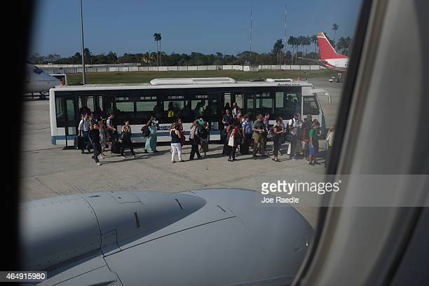 Miamibound passengers exit from a bus as they prepare to board an American Airlines charter plane at José Martí International Airport on March 1 2015...