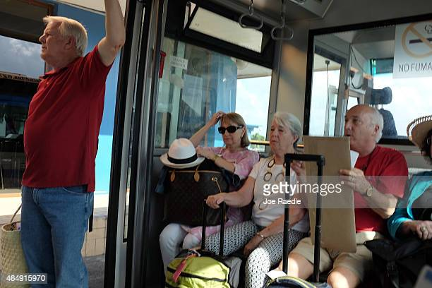 Miamibound passengers sit on a bus as they wait to be brought to an American Airlines charter plane at José Martí International Airport on March 1...