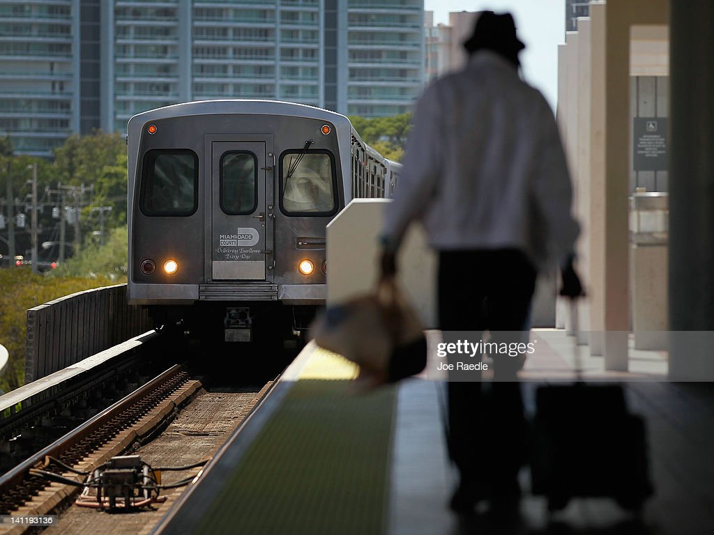 A Miami-Dade county Metrorail train pulls into a station March 12, 2012 in Miami, Florida. With gas prices on the rise, mass transit systems around the country have seen a 2.31 percent rise in ridership during 2011 over the previous year according to the American Public Transportation Association.