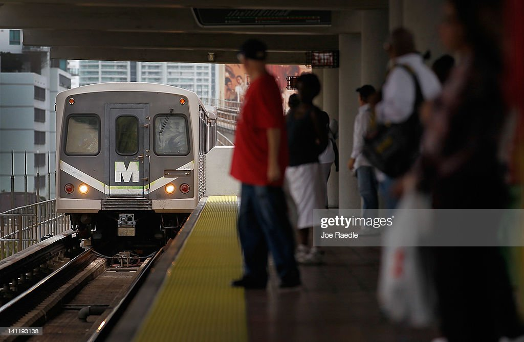A Miami-Dade county Metrorail train pulls into a station on March 12, 2012 in Miami, Florida. With gas prices on the rise, mass transit systems around the country have seen a 2.31 percent rise in ridership during 2011 over the previous year according to the American Public Transportation Association.