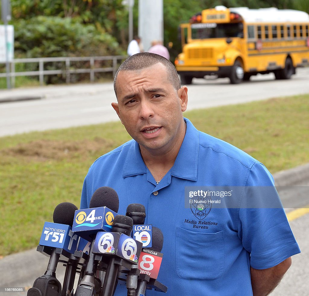 Miami-Dade Police Detective Alvaro Zabaleta briefs the media after a student shot and killed a 13-year-old girl in front of her younger sister and seven other children on a school bus Tuesday morning, November 20, 2012, in Homestead, Florida.