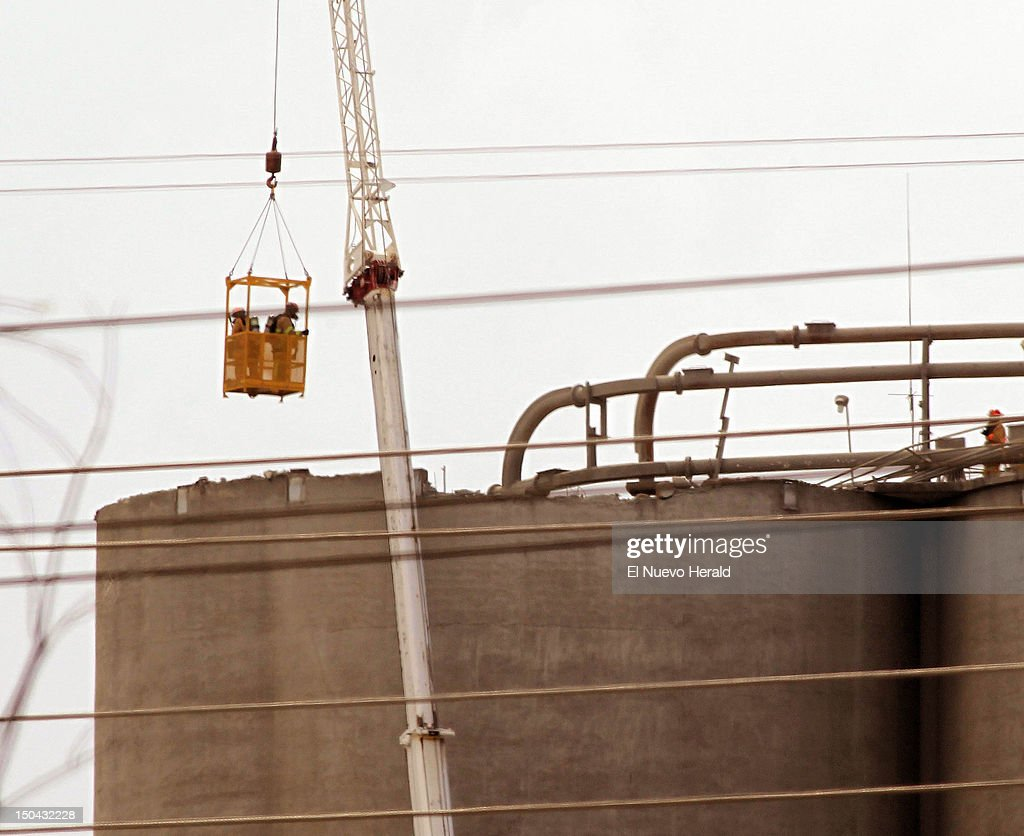 Miami-Dade rescue personnel prepare to enter the silo at the Titan America Cement plant in Medley, Florida, where the roof collapsed, sending a worker into cement 140 feet below on Friday, August 17, 2012.