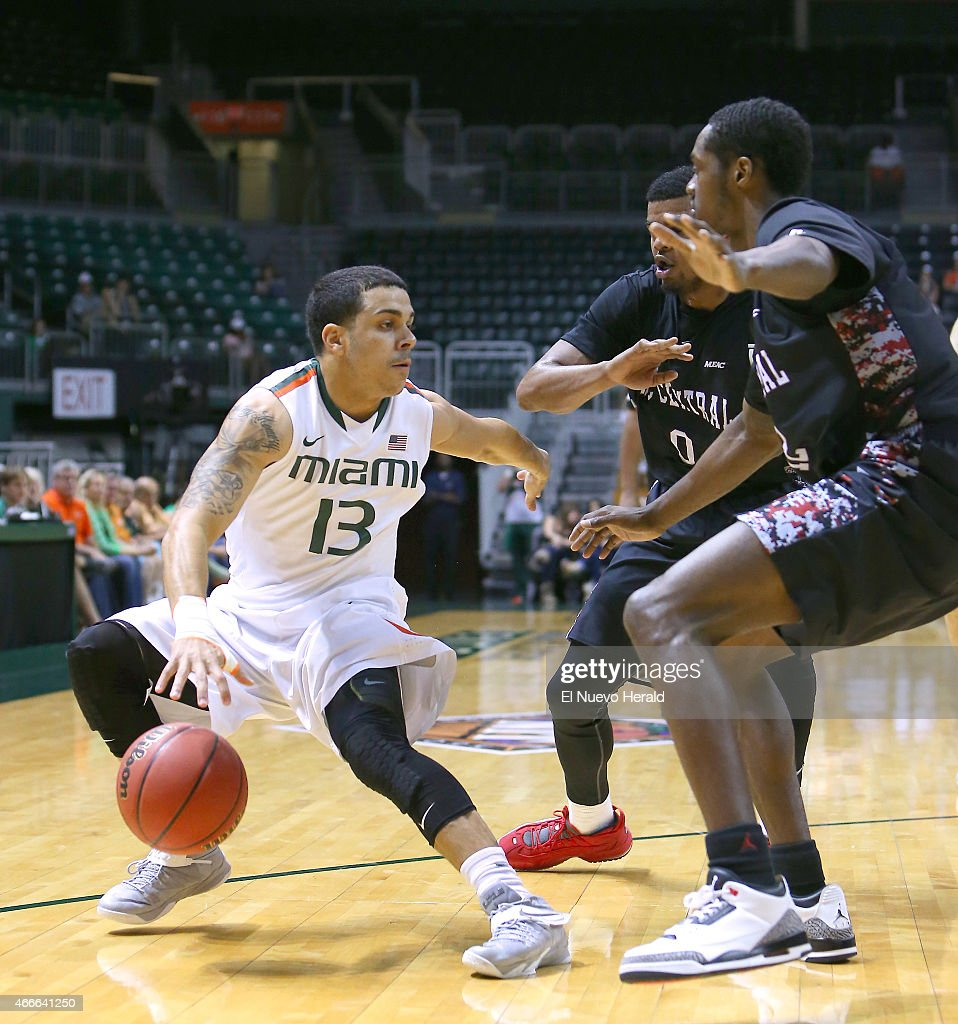 Miami's Angel Rodriguez drives against North Carolina Central's Dante Holmes and Jeremiah Ingram right during the first half of National Invitation...