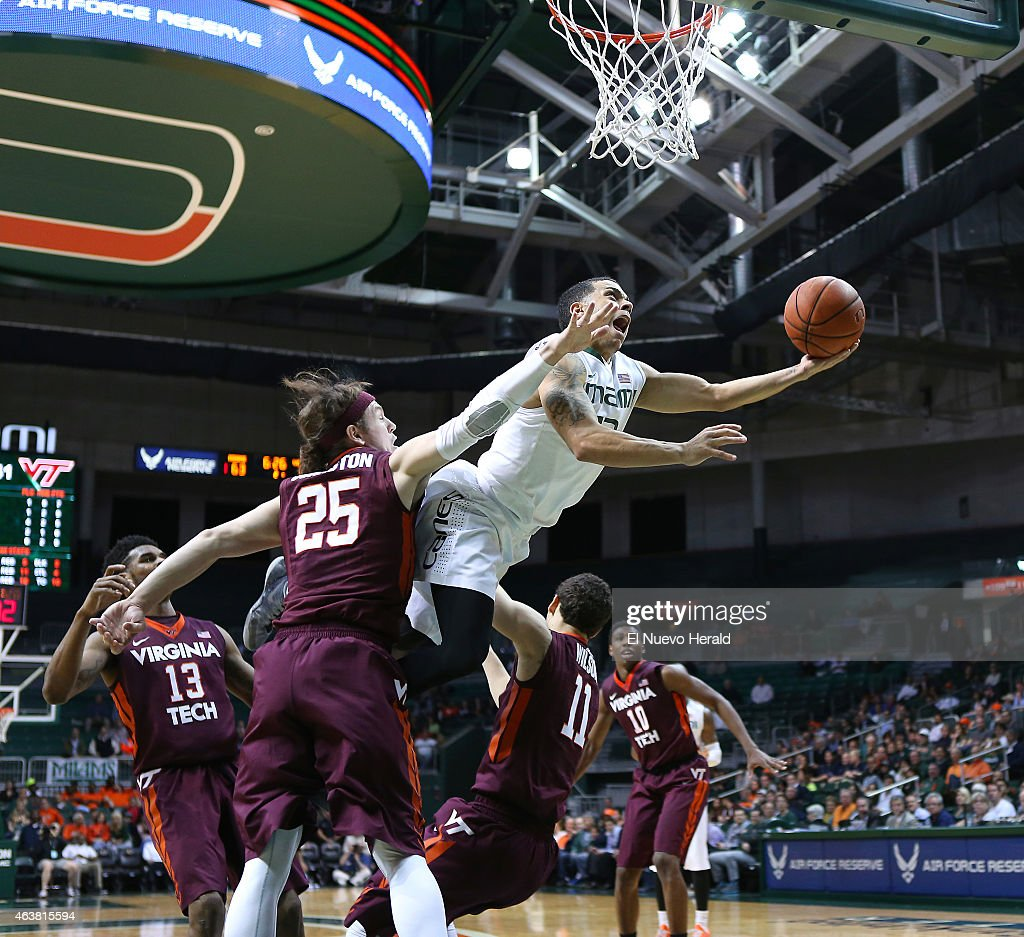 Miami's <a gi-track='captionPersonalityLinkClicked' href=/galleries/search?phrase=Angel+Rodriguez+-+Basketball+Player&family=editorial&specificpeople=10584461 ng-click='$event.stopPropagation()'>Angel Rodriguez</a> goes to the basket against Virginia Tech's Will Johnston (25) and Devin Wilson (11) during the second half at the BankUnited Center in Coral Gables, Fla., on Wednesday, Feb. 18, 2015. The host Hurricanes won, 76-52.