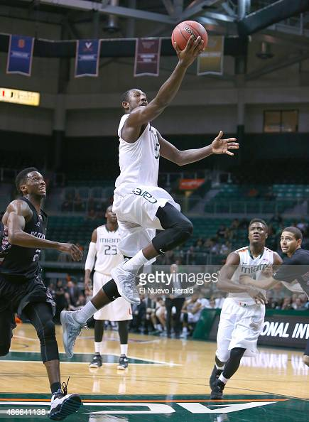 Miami's Davon Reed goes to the basket against North Carolina Central's Jordan Parks left during the first half of National Invitation Tournament...