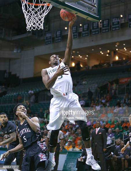 Miami's Davon Reed goes to the basket against North Carolina Central's Anthony McDonald during the first half of National Invitation Tournament...