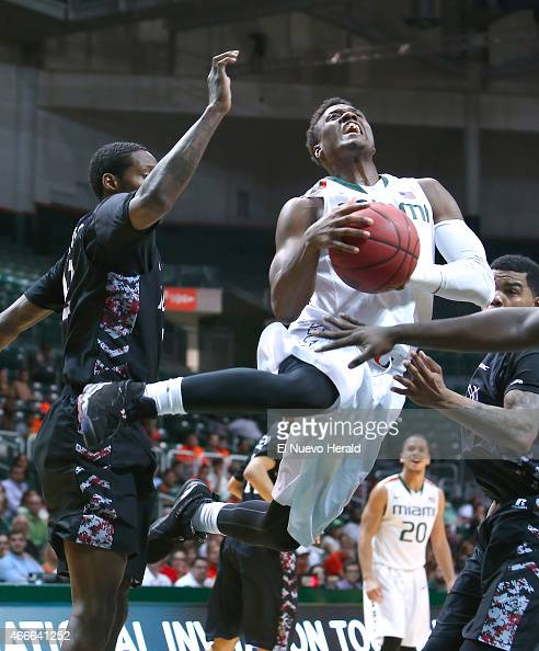 Miami's Deandre Burnett is fouled by North Carolina Central's Jay Copeland left during the second half of National Invitation Tournament firstround...