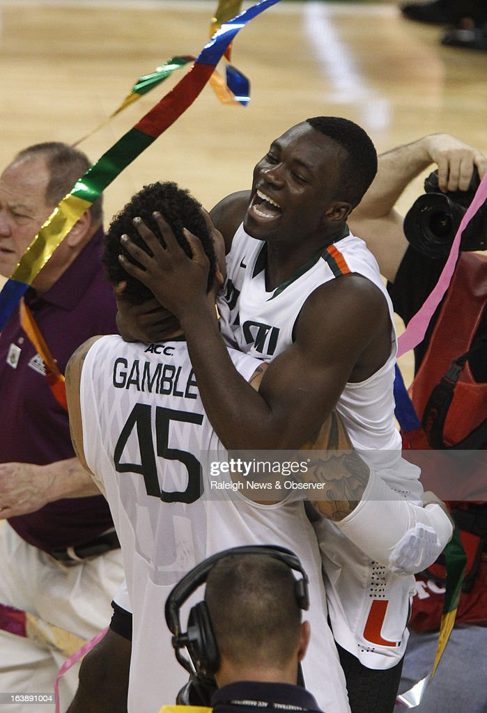 Miami's Durand Scott (1) jumps into the arms of Julian Gamble (45) after the Hurricanes' 87-77 victory over North Carolina in the finals of the men's ACC basketball tournament at the Greensboro Coliseum in Greensboro, North Carolina, Sunday, March 17, 2013.